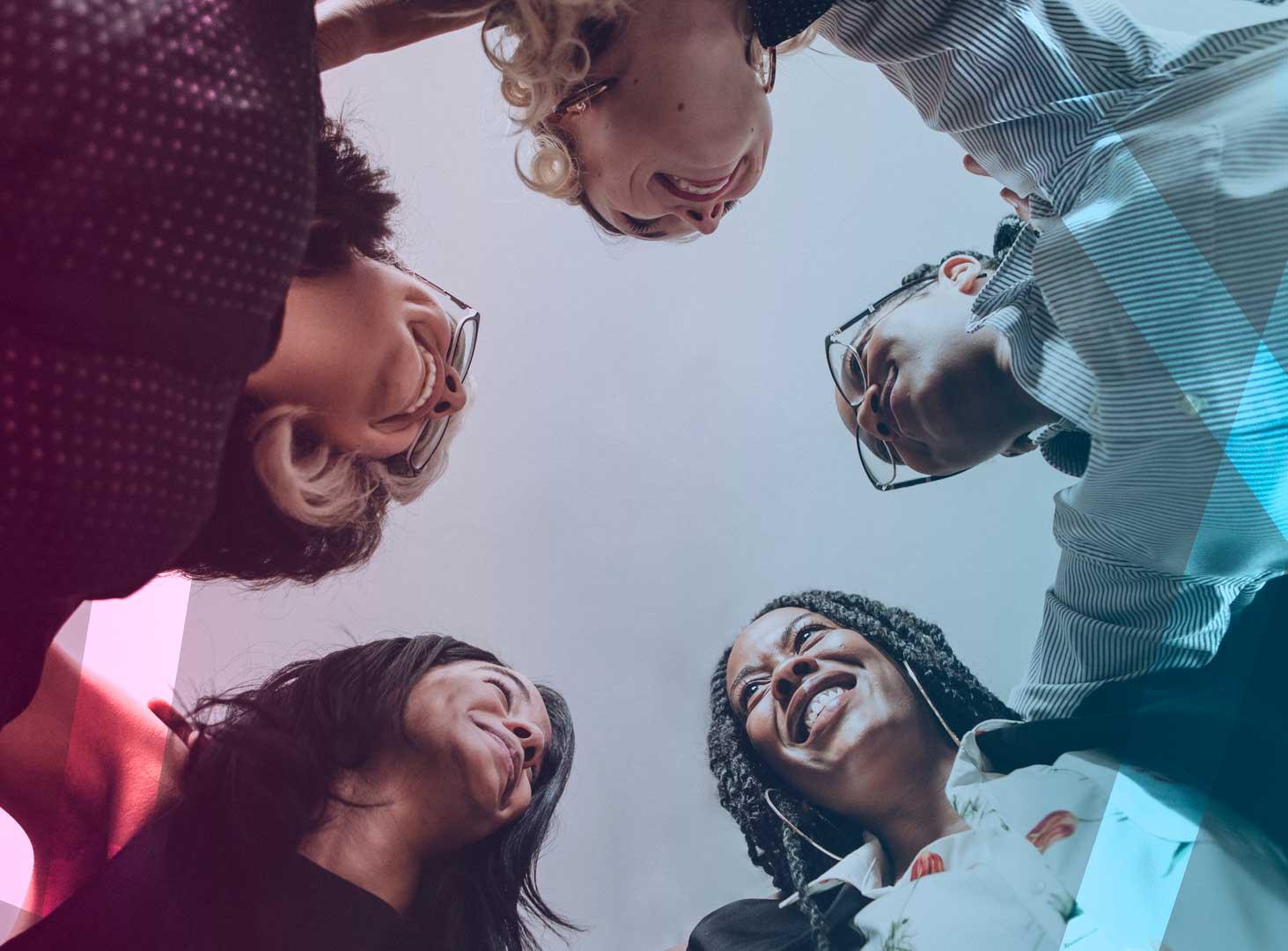 happy-diverse-businesswomen-huddling-in-the-office-optin3